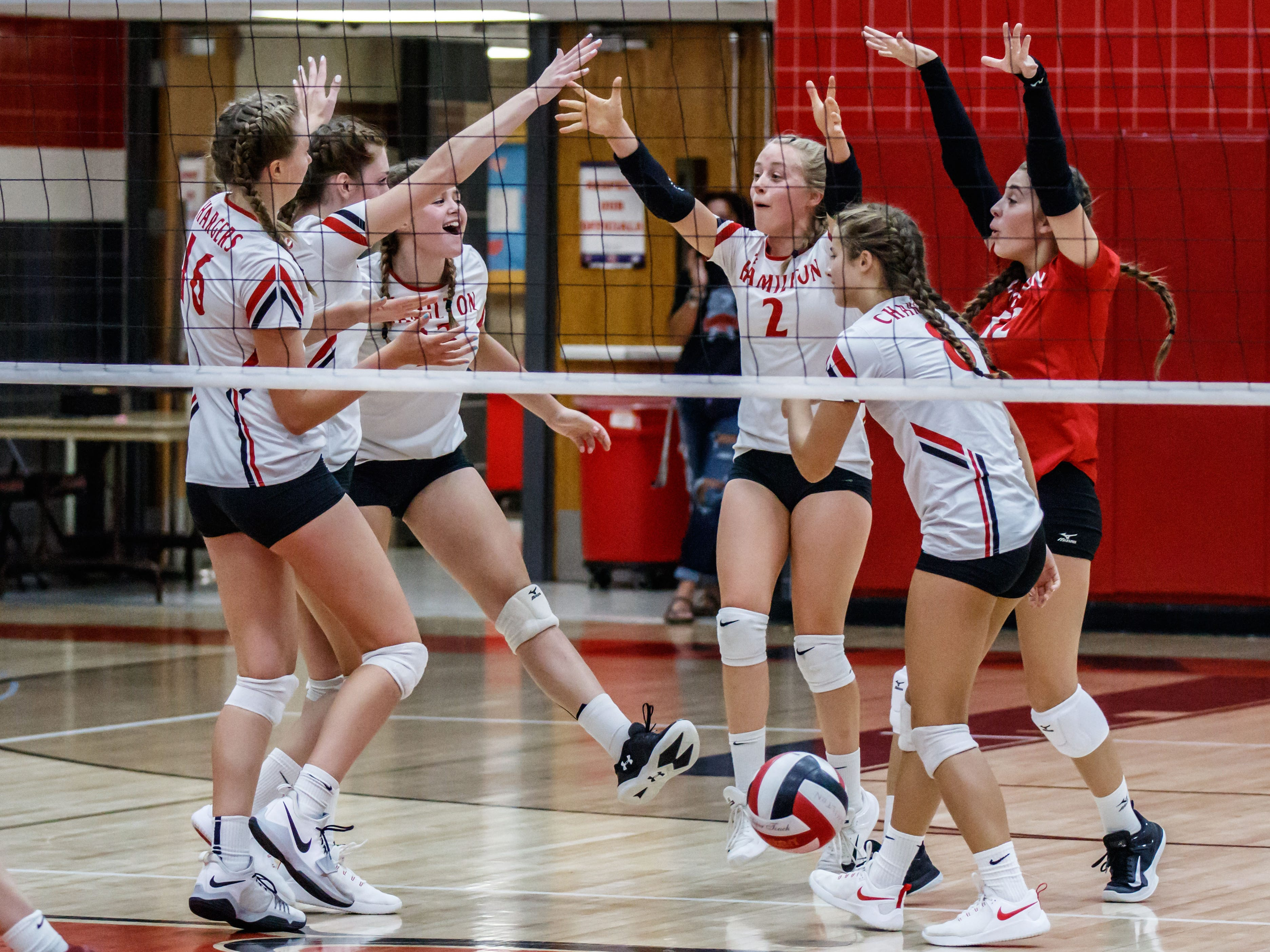 Sussex Hamilton players celebrate a point during the game at home against Menomonee Falls on Tuesday, August 28, 2018.