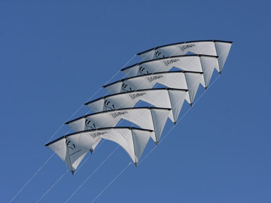 Kite festival-goers can marvel at kites that are flown in formation by professional kite-flyers.