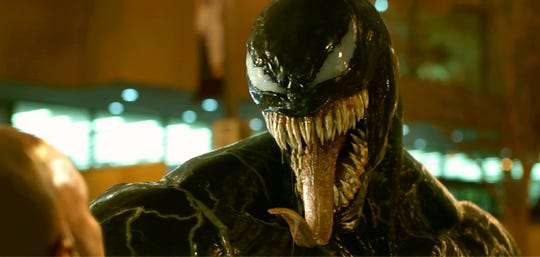 """Tom Hardy (no, really, is in there somewhere) plays a reporter turned super-anti-hero in """"Venom."""""""