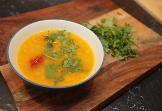 Squash, Leek, and Chickpea Soup with chopped cilantro is a vegetarian soup for celebrating the Jewish New Year.