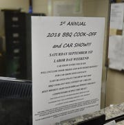 A flyer advertising a barbecue cook-off and automobile show scheduled for Saturday in Big Spring Park is posted at Cotter City Hall. All proceeds from the event will go towards maintaining the park.