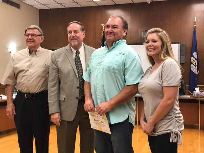 The Ouachita Parish School Board on Tuesday honored bus driver Ben Lilly who saw a vehicle that was going to pass his bus at a high rate of speed and yelled for the kids about to board to stay in a safe spot, avoiding potential tragedy. Shown are: Transportation director Skeeter Boyd, Superintendent Don Coker, bus driver Ben Lilly and Katie Bostick.