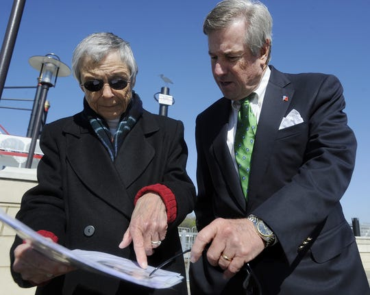 Historian Mary Ann Neeley and Mayor Todd Strange look at historic photographs of the 1886 flood during the unveiling of the high water mark sign at Riverfront Park in Montgomery, Ala. on Friday March 11, 2011. The high water mark sign, visible between Neeley and Strange, shows the level the water reached on February 26, 1961.(Montgomery Advertiser, Mickey Welsh)