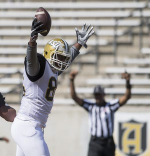 Tight end Larry Brown (86) celebrates a touchdown catch during the Alabama State University Black and Gold Game at Hornet Stadium on the ASU campus in Montgomery, Ala. on Saturday April 28, 2018.
