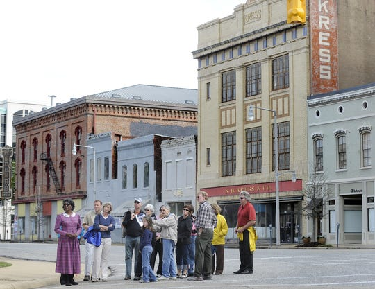 Historian Mary Ann Neeley leads a walking tour of historic Monroe Street on Sunday March 15, 2009 in downtown Montgomery, Ala. The tour had been cancelled because of rainy weather, but when people showed up anyway, Neeley lead the tour.(Montgomery Advertiser, Mickey Welsh)