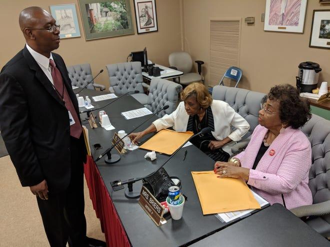 MPS CSFO Arthur Watts speaks to school board members Eleanor Dawkins and Mary Briers on Aug. 28, 2018.