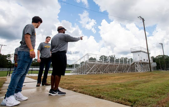 Billingsley football coach Marvin Morton and players check out their new stadium in Billingsley, Ala., on Wednesday August 29, 2018 as they prepare for this week's opener.