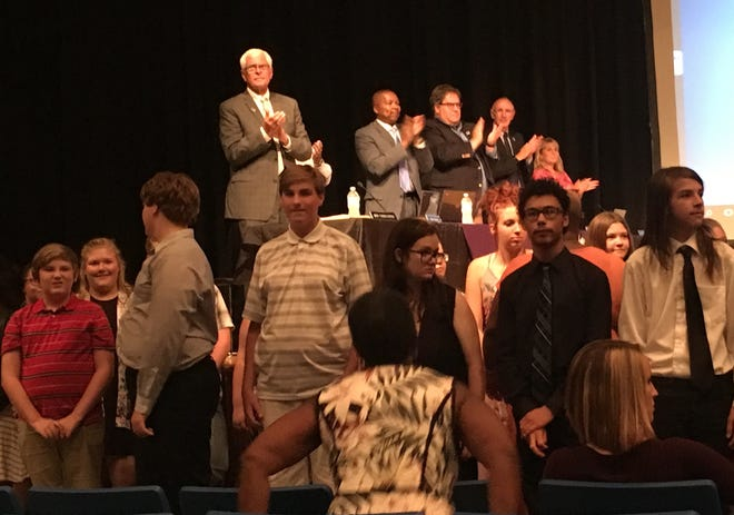 Muncie Central Spirit of Muncie band members receive a standing ovation from the audience and school officials at a school board meeting Tuesday night at Central High School. The band finished in the top ten at the State Fair band contest.