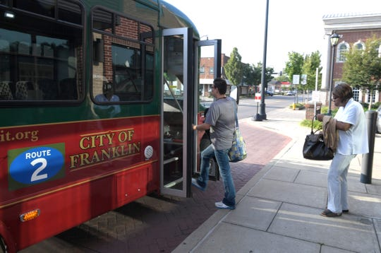 Kelly Perales and Betty Brown board a Franklin Transit Authority bus in downtown Franklin on Aug. 28, 2018.