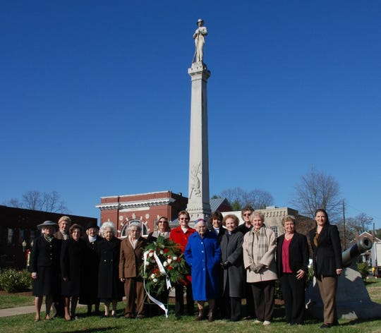 Members of Franklin Chapter 14, United Daughters of the Confederacy, placed a wreath at the Confederate monument on the square to honor the 143rd anniversary of the Battle of Franklin.  The Franklin Chapter 14, UDC, was chartered Oct. 28, 1895, and purchased the monuments in 1899. They also maintain the McGavock Confederate Cemetery near Carnton Plantation. (In photo: Betty J. Chalfant, Mary Howard, Rita Gathmann, Kathryn Sanders, Bertha Gathmann, Ann Moran, Cynda Ferguson, Louise Beauchamp, Virgina Bowman, Nancy Taylor, Jane Brophy, Sylvia Tywater, Liz Plattsmier, Leslie Tudahl, Elizabeth Coker)