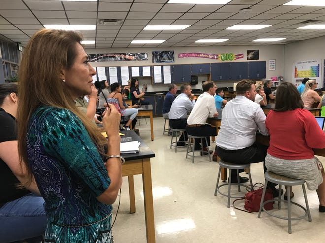 Franklin Special School District Parent Liaison Amelia Cole translates for Spanish-speaking families during an orientation at Poplar Grove Middle School.