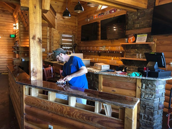 Owner Andrew Deal working on the new Jefferson's location soon to open in Fairview.