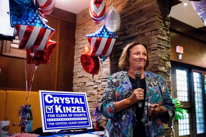 Crystal Kinzel gets emotional during her watch party at Bokampers in North Naples on Tuesday, Aug. 28, 2018, as she speaks to the crowd after seeing updated results that projected her win over Don Berry for the clerk of courts.