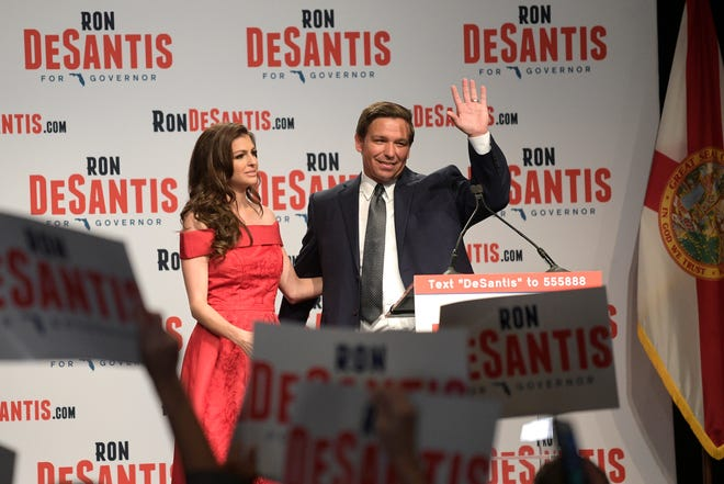 Florida Republican gubernatorial candidate Ron DeSantis, right, waves to supporters with his wife, Casey, at an election party in Orlando after winning the Republican primary on Tuesday, Aug. 28, 2018