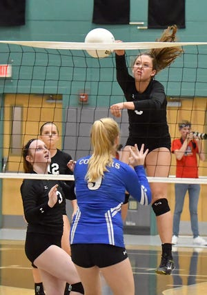 Gulf Coast High School's Grace Vernon (8) goes up for the spike during their match with Barron Collier at Gulf Coast on Tuesday. The Sharks won in four sets.