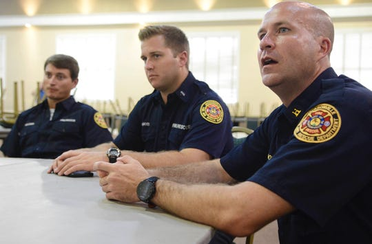 Jacksonville fire Capt. Jeremy Cooke discusses how and he and fellow firefighters rendered aid Aug. 26, 2018, to victims fleeing the Madden NFL 19 shooting. Joining him are firefighter Patrick Walden, left, and fire engineer Austin Mays, middle.