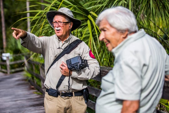 Margarit Leutort, 91, of Naples takes a guided tour led by volunteer Jerry Jackson at the Audubon Corkscrew Swamp Sanctuary on Wednesday, Aug. 29, 2018.