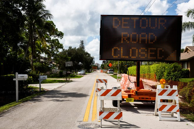 A sign directs traffic to an alternate route along Vanderbilt Drive in North Naples on Wednesday, Aug. 29, 2018. Completion of construction on the road has been delayed until September 2019.