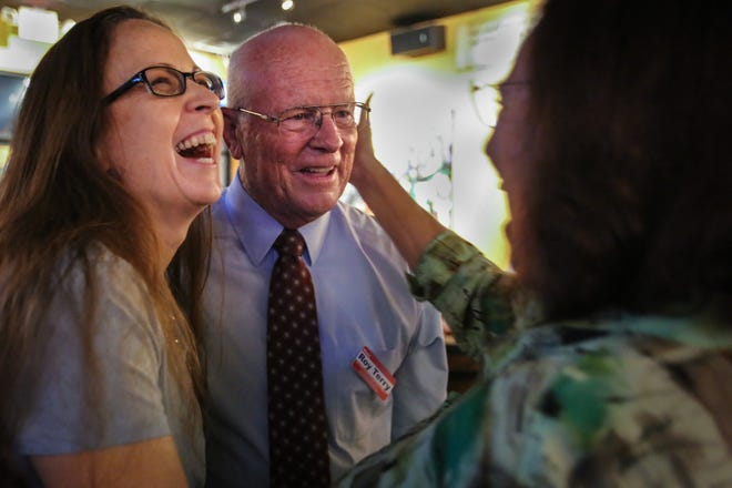 Collier County School Board incumbent Roy Terry celebrates his win with his campaign manager Cyndee Woolley, left, and former School Board member Kathy Curatolo, right, Tuesday, Aug. 28, 2018, at South Street Grill. Terry reclaimed his District 5 seat for a third term.