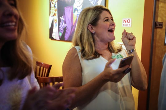 Jen Mitchell celebrates as preliminary School Board election results appear on TV Tuesday, Aug. 28, 2018, at South Street Grill. Mitchell will replace Erika Donalds to represent District 3.