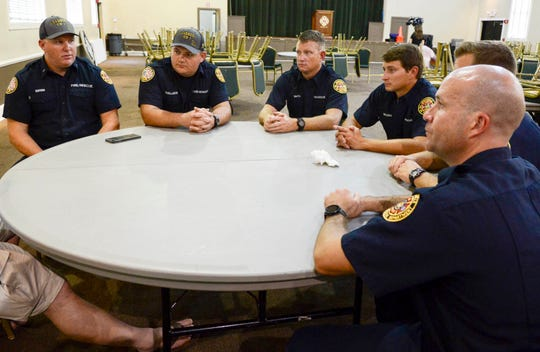 Six Jacksonville firefighters on Aug. 27, 2018, discuss their efforts to aid victims fleeing the Madden NFL 19 video game tournament shooting a day earlier at Jacksonville Landing.