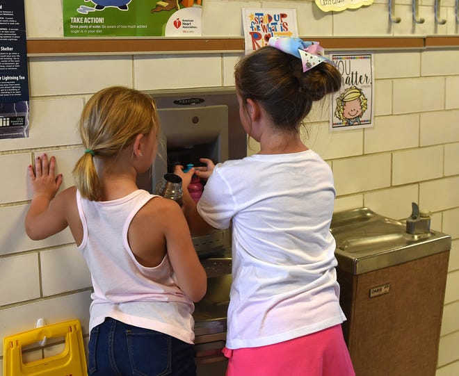 Students at Garfield Elementary School take a break to fill up water bottles on Wednesday, Aug. 29, 2018 at Garfield Elementary School. With high heat in the area fans were brought in to help circulate air and students and teachers made sure to stay hydrated through out the day.
