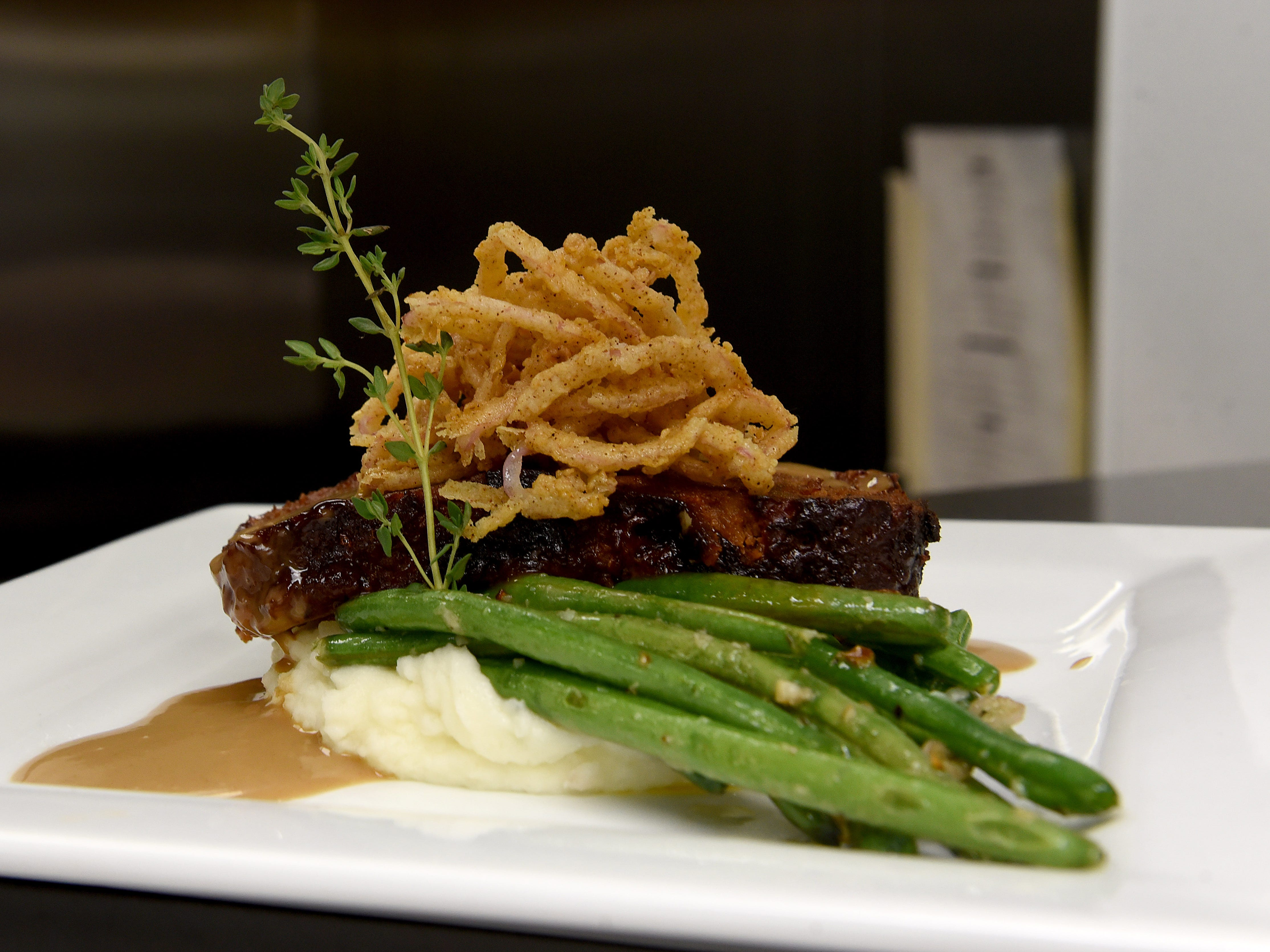 Mama's Chorizo Meatloaf with asiago mashed potatoes, sautéed green beans, a Demi cream gravy, and crispy onions from The Loft at Cumberland. The Pataskala restaurant is part of Cumberland Trail Golf Club.