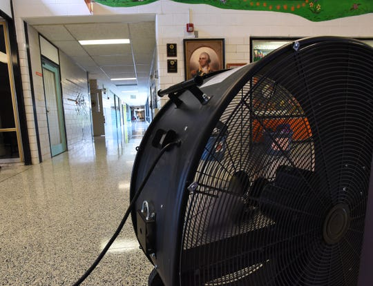 A large fan blows air down one of the main hallways at Garfield Elementary School in Heath. Fans helped circulate air to keep students and staff cool. Students also took water breaks to stay hydrated.