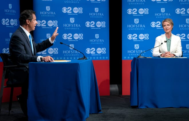New York Gov. Andrew Cuomo answers a question as Democratic New York gubernatorial candidate Cynthia Nixon looks on during a gubernatorial debate at Hofstra University in Hempstead, N.Y., Wednesday, Aug. 29, 2018. (AP Photo/Craig Ruttle, Pool)