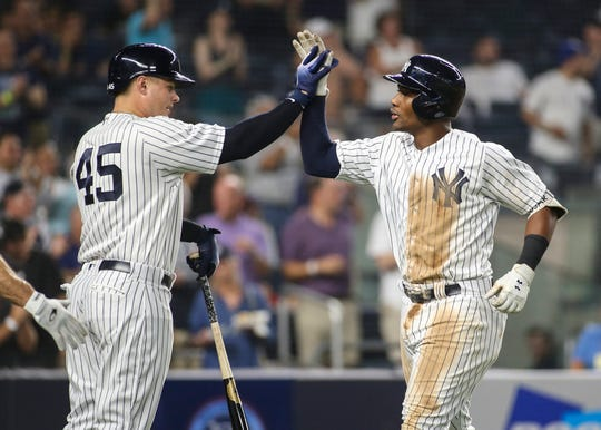 New York Yankees third baseman Miguel Andujar (41) is greeted by designated hitter Luke Voit (45) after hitting a two run home run in the sixth inning against the Chicago White Sox at Yankee Stadium.