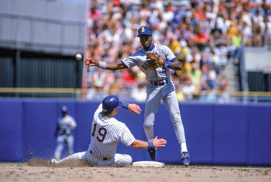 Harold Reynolds turns a double play for the Seattle Mariners during the 1990 MLB season.