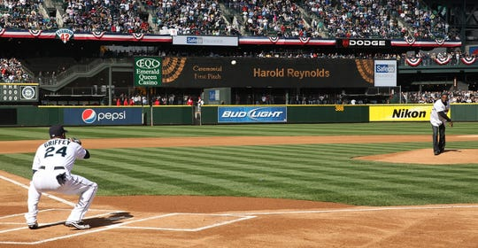 SEATTLE - APRIL 14:   Harold Reynolds throws out the ceremonial first pitch to Ken Griffey Jr. before the Los Angeles Angels of Anaheim and the Seattle Mariners Opening Day game on April 14, 2009 at Safeco Field in Seattle, Washington. (Photo by Otto Greule Jr/Getty Images)