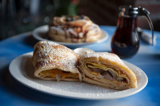 The country breakfast wrap with Nutella pancakes in the background from The Brownstone Pancake Factory  AMY NEWMAN/STAFF PHOTOGRAPHER