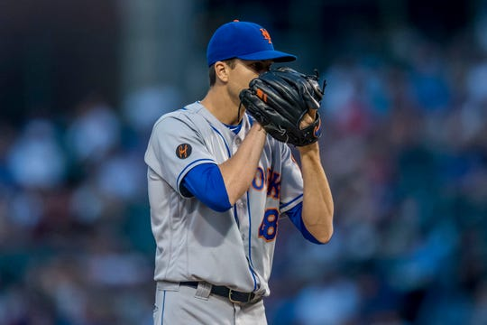Aug 28, 2018; Chicago, IL, USA; New York Mets starting pitcher Jacob DeGrom (48) prepares to pitch during the first inning against the Chicago Cubs at Wrigley Field.
