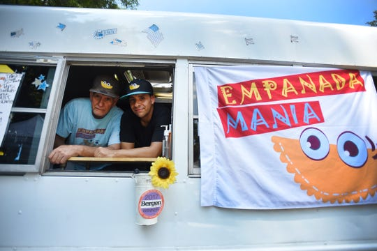 Galo Grijalva Jr. (R) of Cresskill and his father, Galo Grijalva Sr. (L) of Dumont, with their truck called Empanada Mania at the Paramus Farmers' Market on 08/29/18.