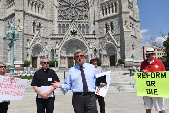 Robert Hoatson, co-founder and president of victims' advocacy group Road to Recovery, speaking in front of the Cathedral Basilica of the Sacred Heart in Newark