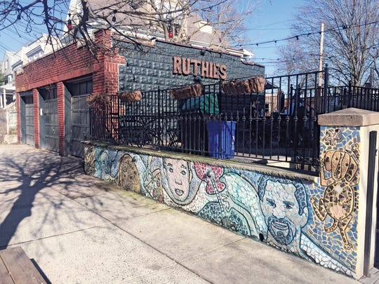 A student-created mural defines where guests take in the music at Ruthie's Bar-B-Q & Pizza in Montclair