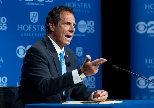 New York Gov. Andrew Cuomo answers a question during a gubernatorial debate with Democratic New York gubernatorial candidate Cynthia Nixon at Hofstra University in Hempstead, N.Y., Wednesday, Aug. 29, 2018. (AP Photo/Craig Ruttle, Pool)