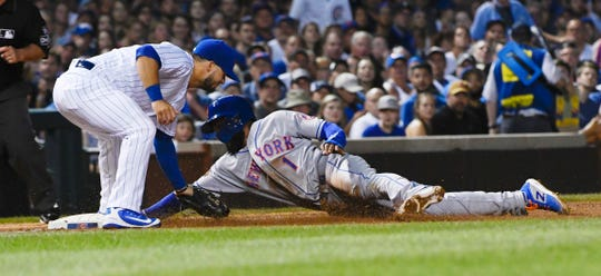 New York Mets' Amed Rosario (1) is caught stealing third base by Chicago Cubs third baseman David Bote, left, during the third inning of a baseball game on Tuesday, Aug. 28, 2018, in Chicago.