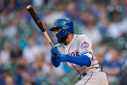 Aug 28, 2018; Chicago, IL, USA; New York Mets shortstop Amed Rosario (1) hits a double during the first inning against the Chicago Cubs at Wrigley Field.