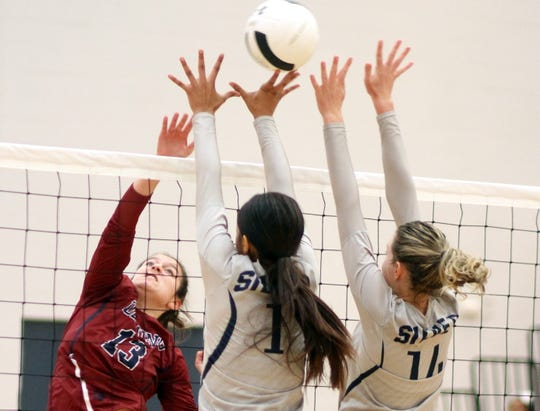Sophomore outside hitter Katie Morgan (13) stepped up for the Lady 'Cats in Tuesday's 3-1 match win over the visiting Silver Colts. Morgan collected 7 kills, 10 blocks and 2 ace serves.