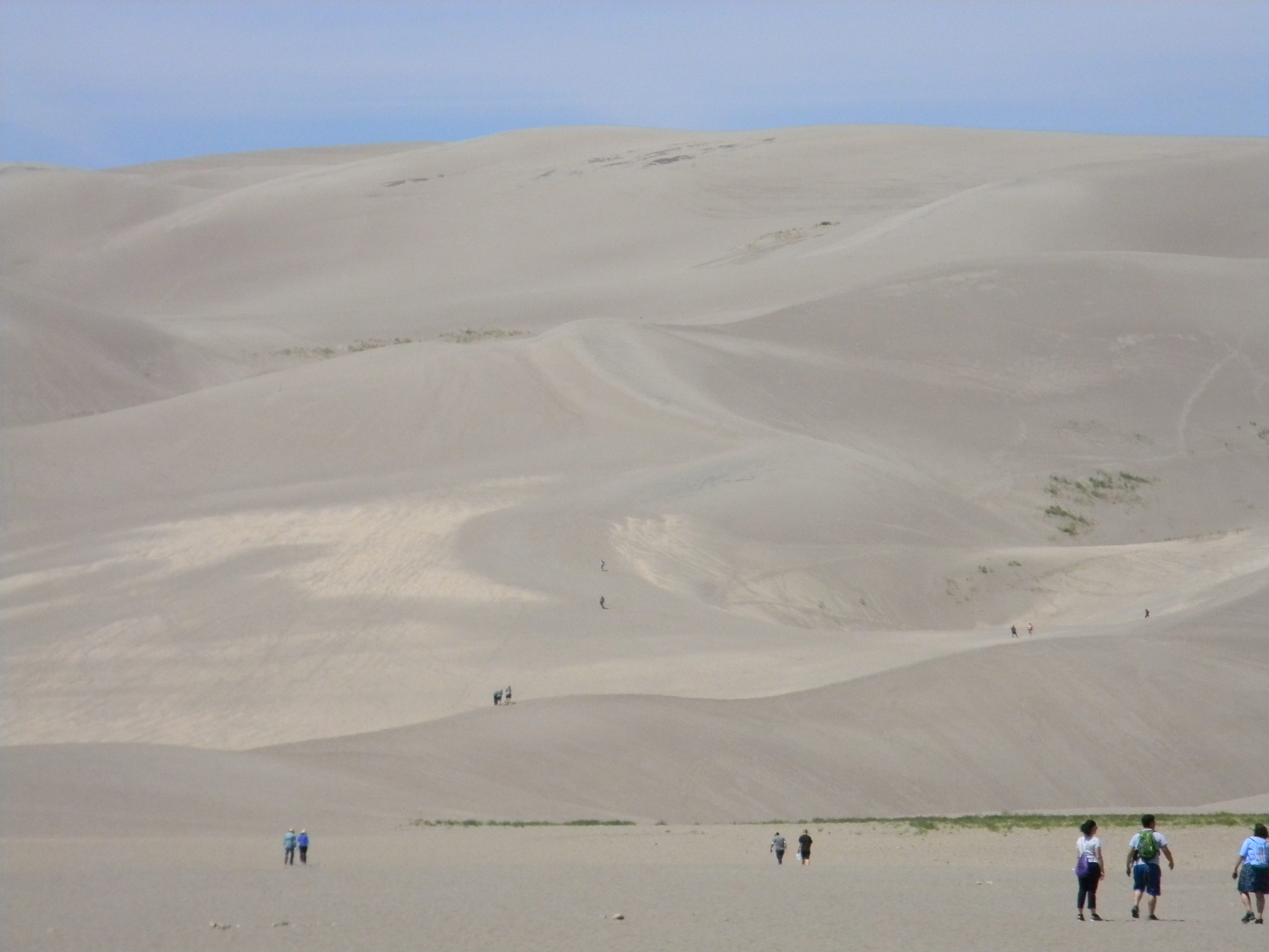 Like ants on an African anthill, climbers tackle the challenge of getting to the summit at Great Sand Dunes National Park.