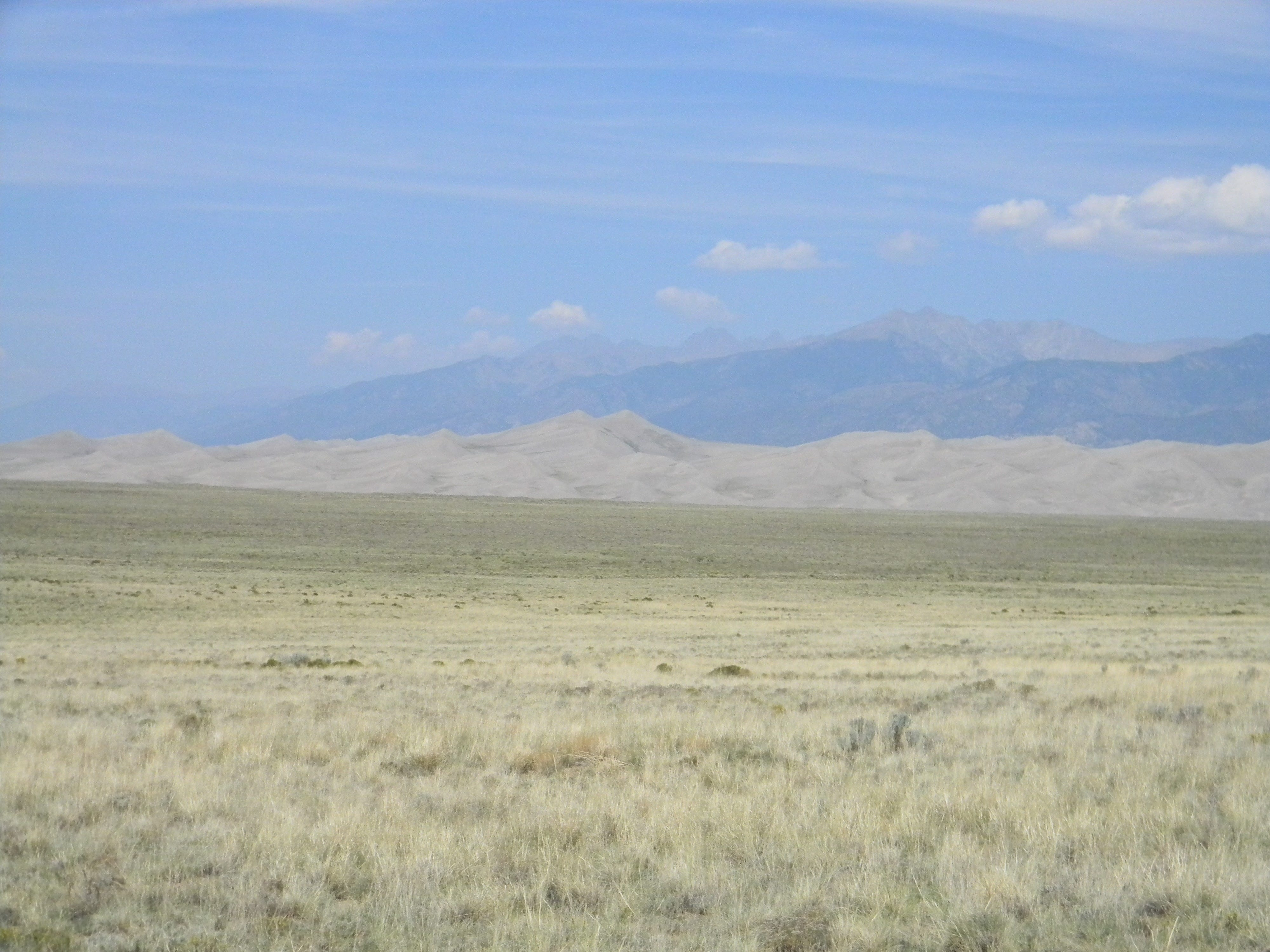 Alternate view of Sangre de Cristo mountains and great sand dunes, foreground, at Great Sands Dunes National Park.
