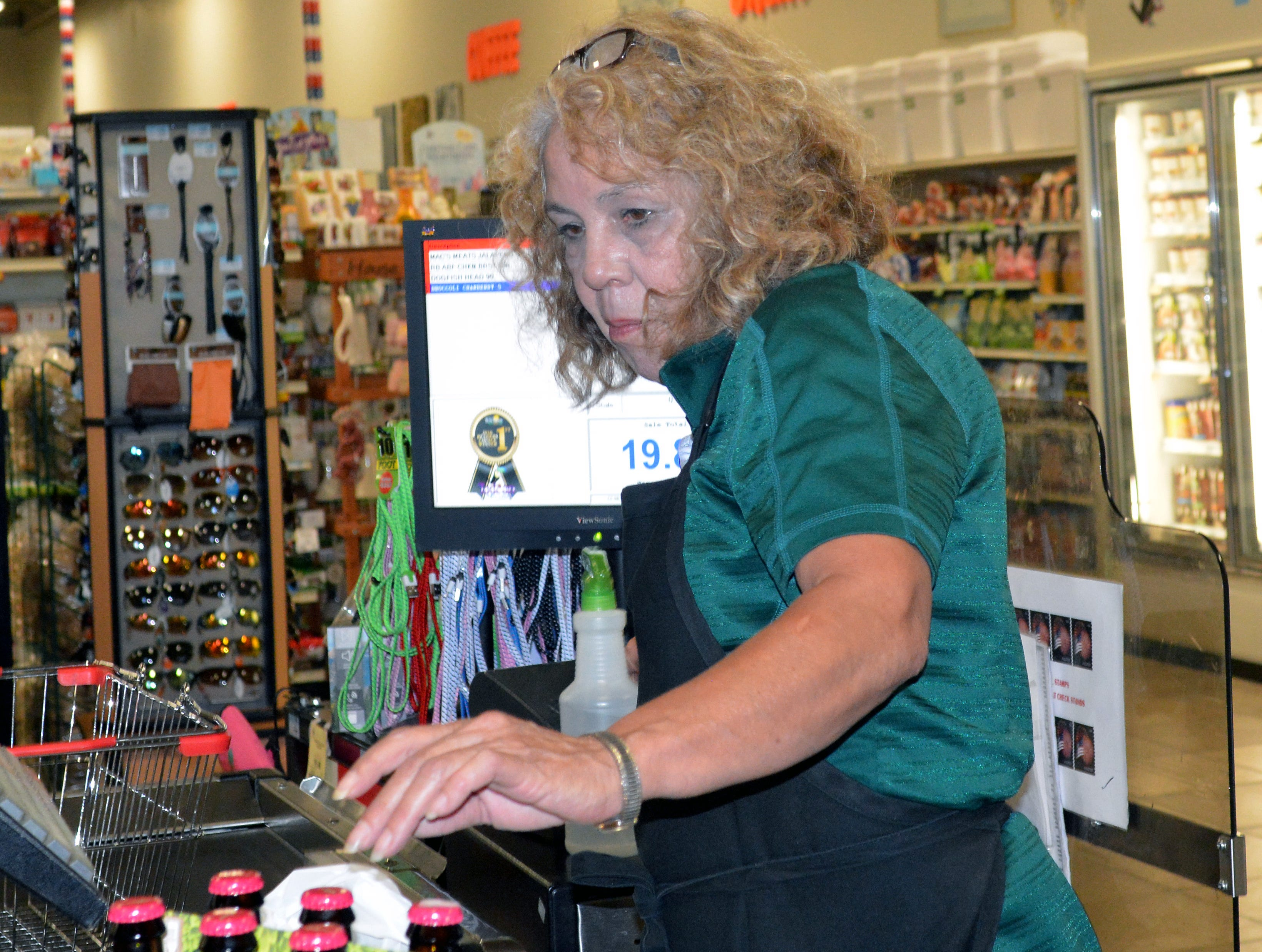 Toucan Market cashier Donna Villarreal has been working at the store for 13 years. She checked out groceries on August 29, 2018.
