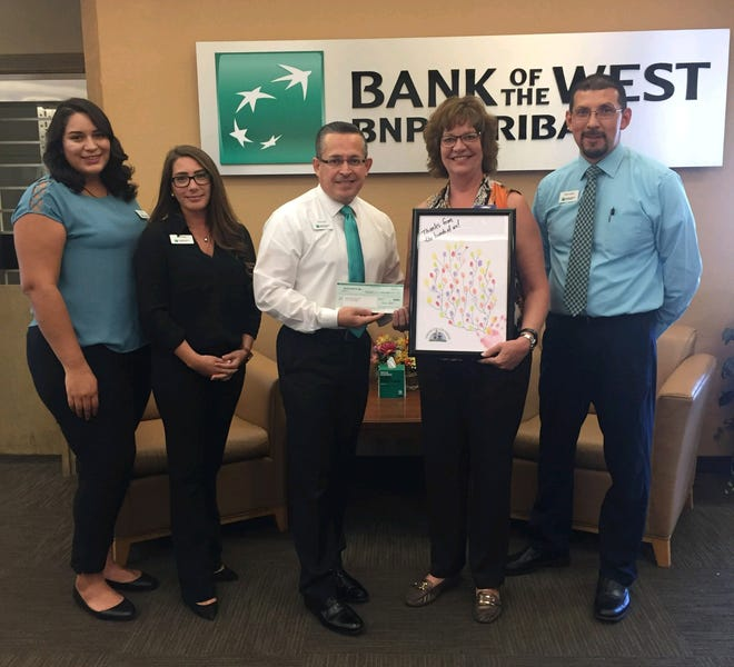 Bank of the West BNP Paribas Community Support presents a grant check to Jardín de los Niños. From Left: Liz Torres; Rachel O'hara; Osvaldo Luna, Bank of the West vice president branch manager; Patty Groth, interim executive director for Jardín; and Michael Zamora.