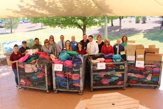 Employees from Las Cruces Public Schools and MountainView Regional Medical Center pose with 600 backpacks filled with school supplies. MountainView donated the backpacks to students of Las Cruces Public Schools on Monday, Aug. 6.
