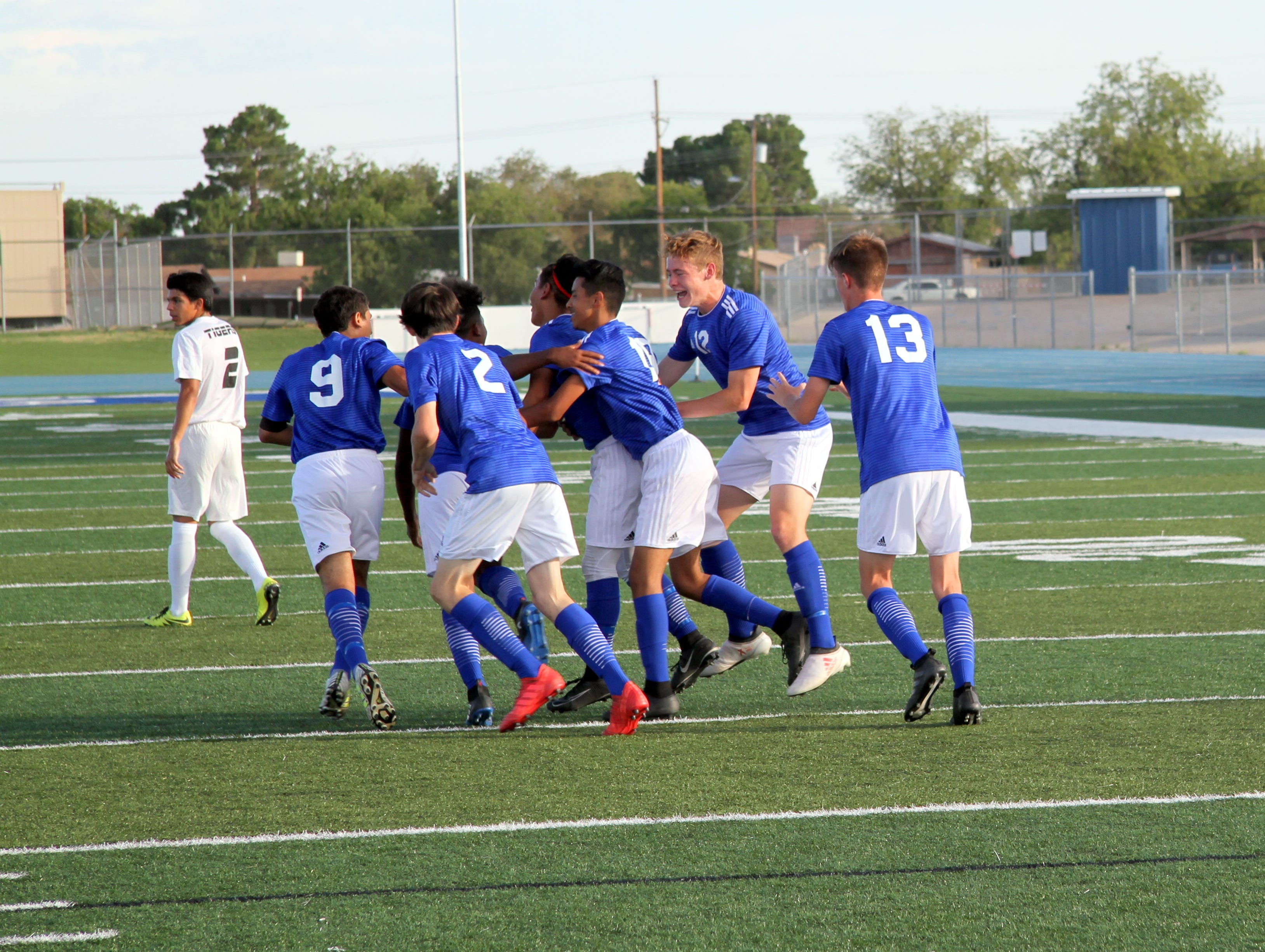 The Carlsbad Cavemen celebrate Denilson Aguilar's goal in the first half of Tuesday's match.