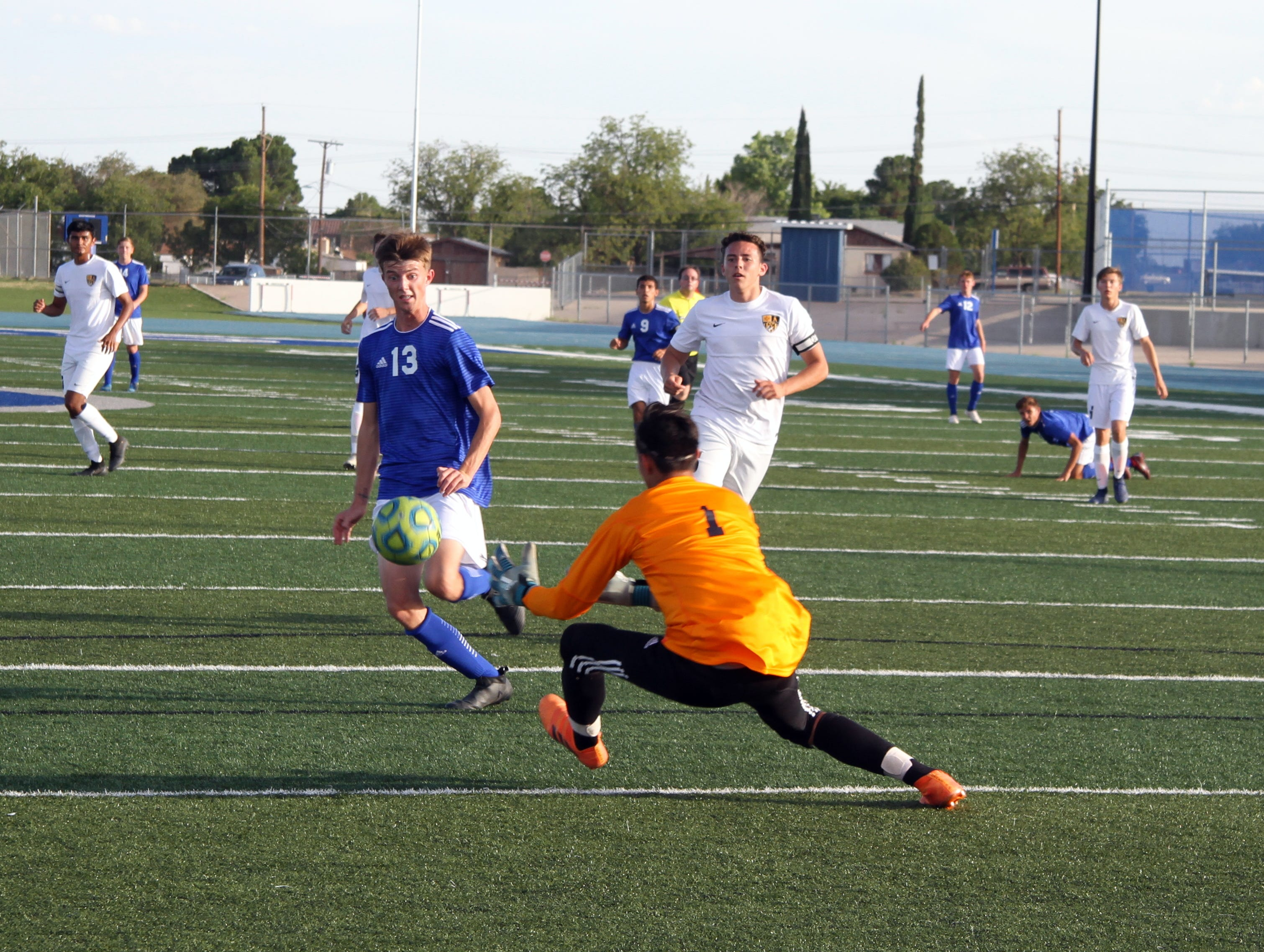 Alamogordo keeper Logan Reyes stops a shot attempt by Carlsbad's Austin Naylor in the first half of Tuesday's contest.