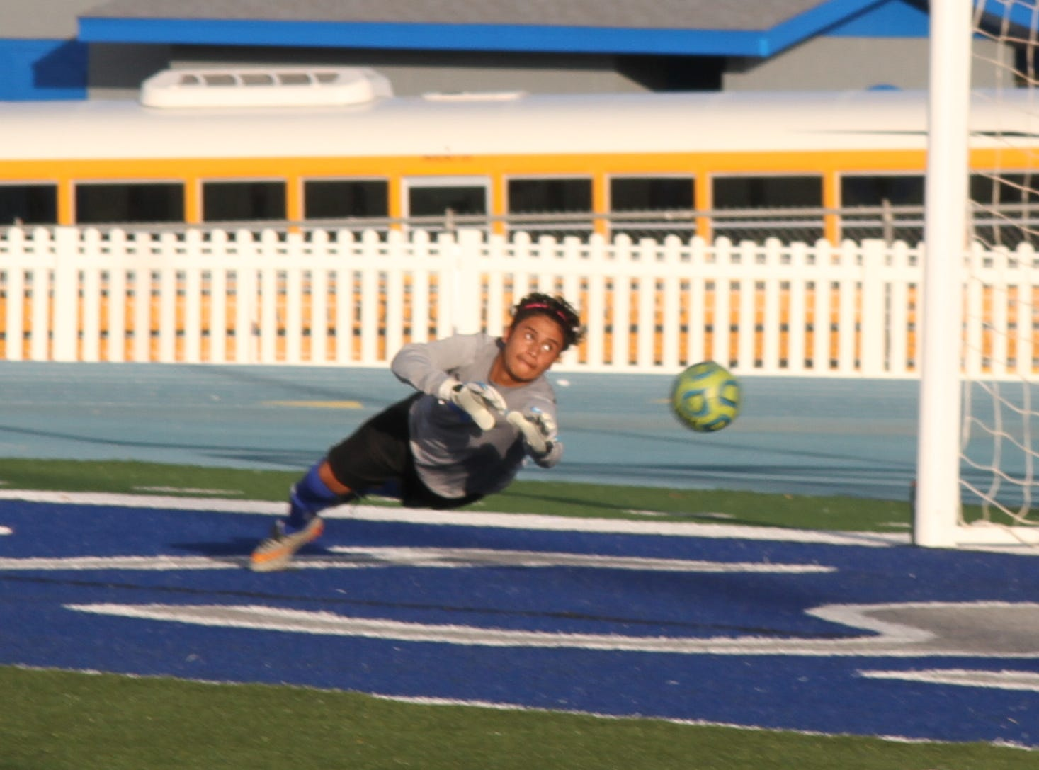 Carlsbad keeper Eduardo Aguilar dives to redirect a shot attempt in the second half of Tuesday's match against Alamogordo.