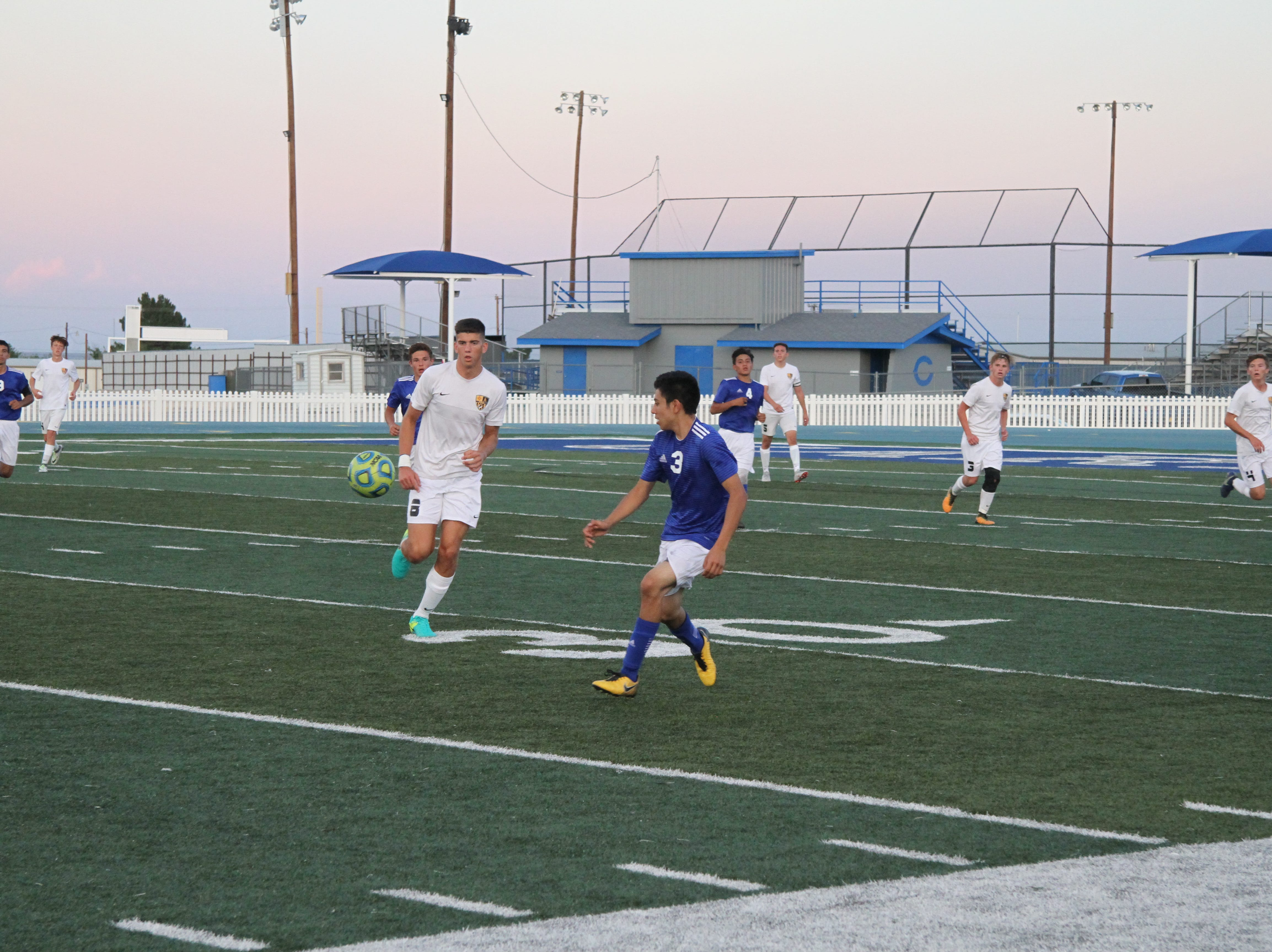 Carlsbad's Nate Martinez and Alamogordo's Lucas Burch fight race toward the ball in the second half of Tuesday's match.